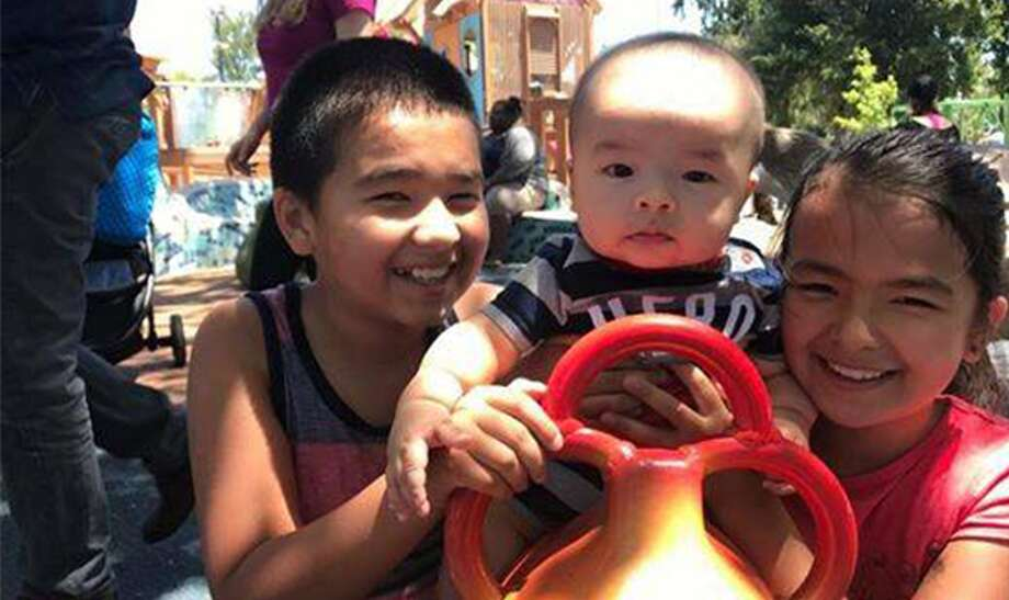 Kelvin Hodges, 11, Julie Hodges, 9, and Lucas Hodges, 7 months Photo: Xao Vang
