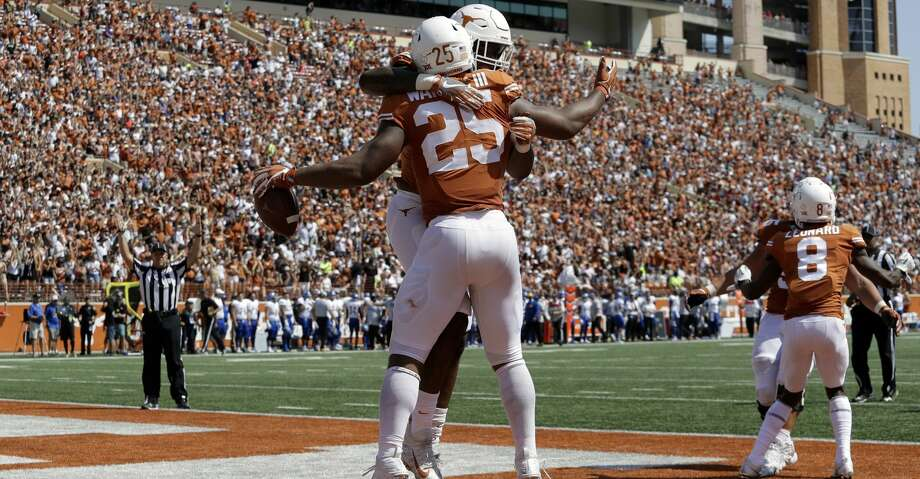 Texas running back Chris Warren III (25) celebrates his 41-yard run touchdown during the first half of an NCAA college football game, Saturday, Sept. 9, 2017, in Austin, Texas. (AP Photo/Eric Gay) Photo: Eric Gay/Associated Press