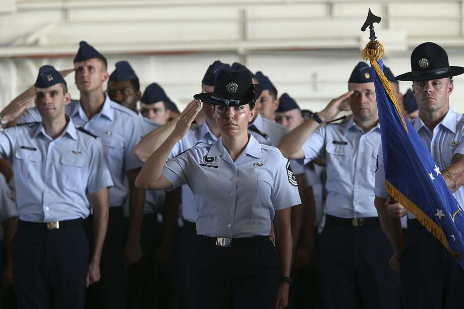Flights of Airmen salute the flag during a change of command ceremony at the Air Education and Training Command, Joint Base San Antonio-Randolph in 2015. The education of airmen has adapted to meet emerging needs. Photo: JERRY LARA /San Antonio Express-News / © 2015 San Antonio Express-News