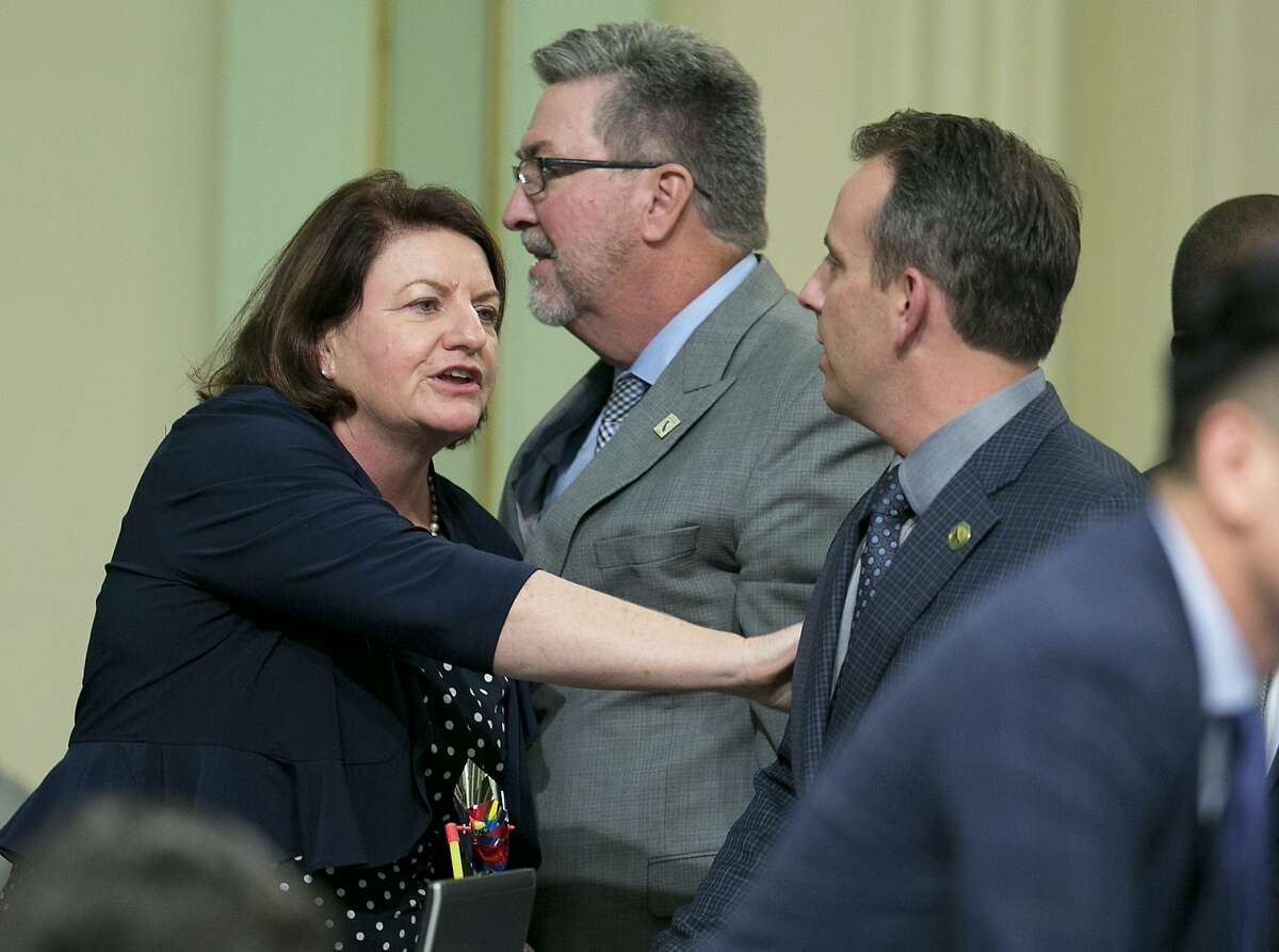 State Sen. Toni Atkins, D-San Diego, thanks Assemblyman Marc Levine, D-San Rafael, after he voted for her housing measure before the state Assembly, Thursday, Sept. 14, 2017, in Sacramento, Calif. Six bills aimed at addressing the crisis cleared the Assembly late Thursday after months of negotiations and cajoling. The bills all need Senate approval on Friday.