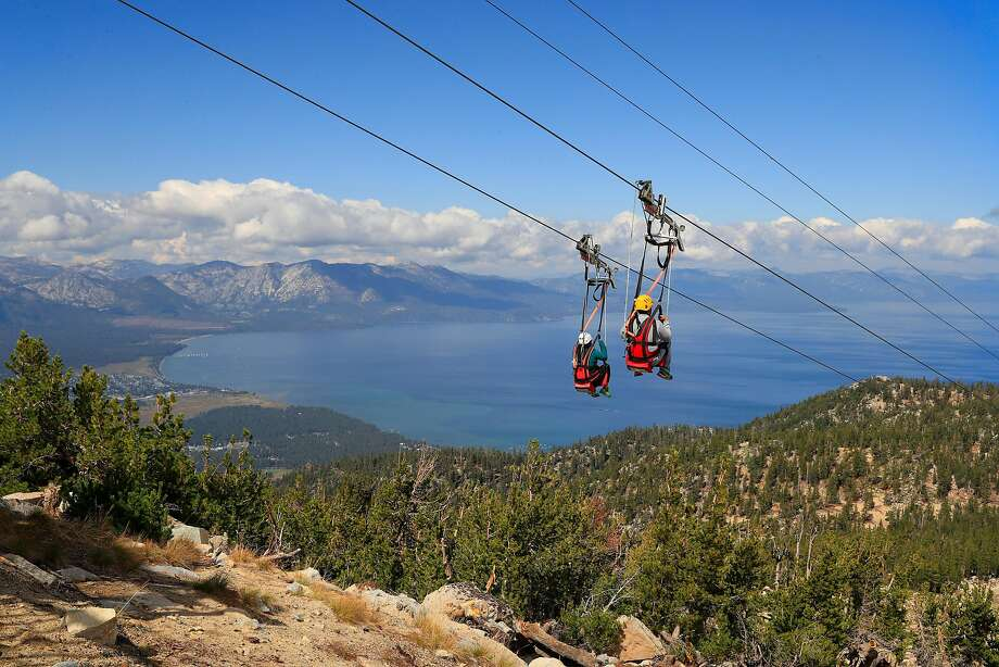Riders soar above the peaks on the Blue Streak Zip Line one of the many summer activities at the Heavenly Mountain Resort as seen on Friday September 15,  2017, in South Lake Tahoe, Ca. Photo: Michael Macor, The Chronicle