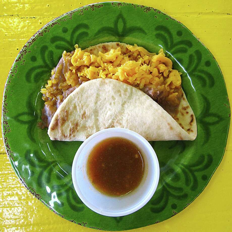 Bean and cheese taco on a handmade flour tortilla from Frijoles Mexican Restaurant. Photo: Mike Sutter /San Antonio Express-News