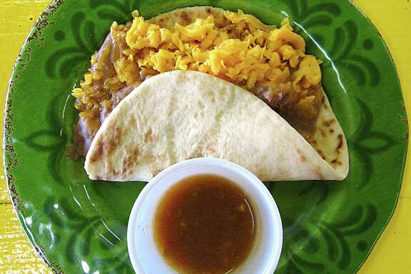 Bean and cheese taco on a handmade flour tortilla from Frijoles Mexican Restaurant.