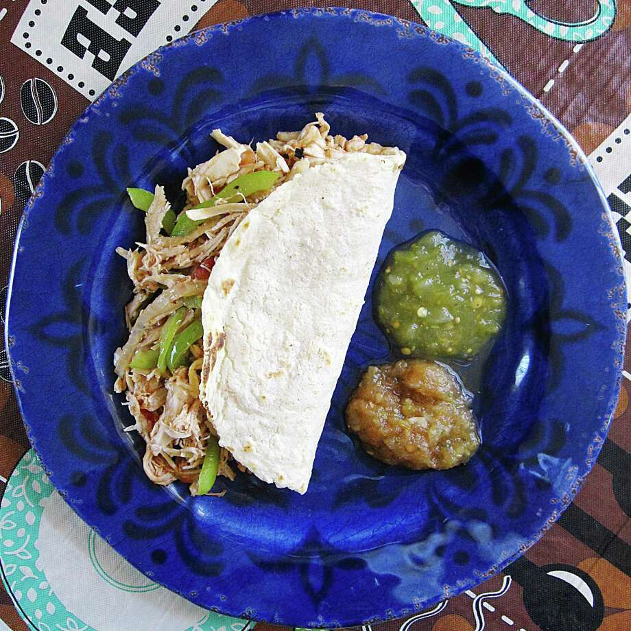 Pollo guisado taco on a handmade corn tortilla from Millie's Cafe. Photo: Mike Sutter /San Antonio Express-News