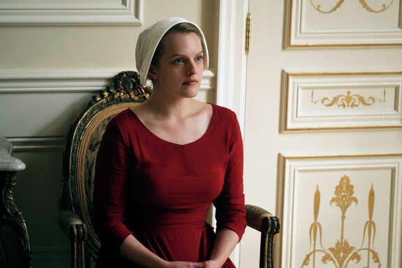 """The Handmaid's Tale,"" starring Elisabeth Moss, is nominated for an Emmy Award for outstanding drama series. Moss is nominated for best actress in a drama for her turn as Offred."