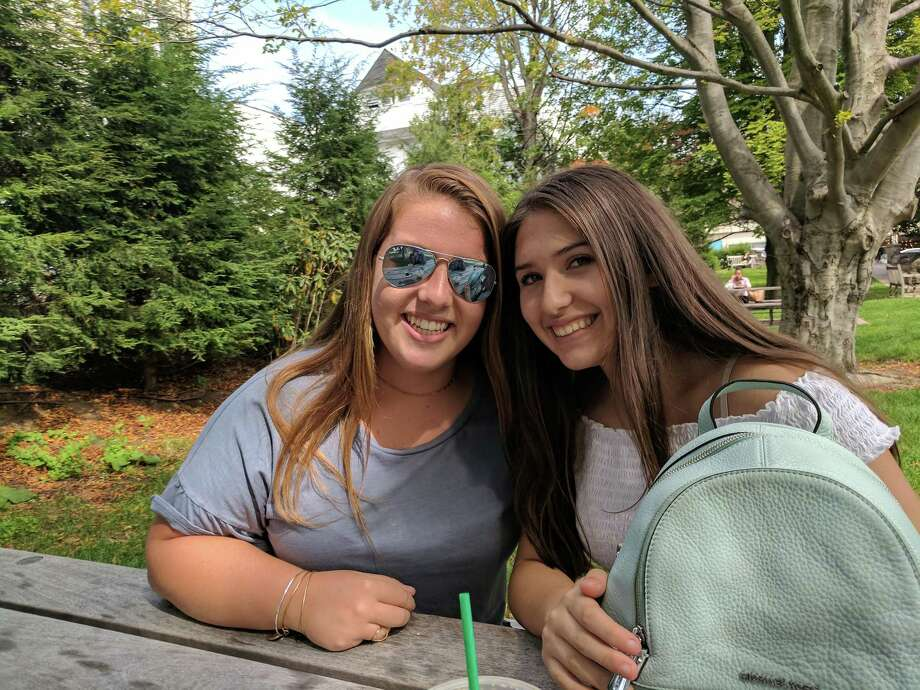 Victoria Ceci (left), 14, and Andreia Pelaez, 15, are starting off their first year at Greenwich High School together — experiencing all the differences from Central Middle School together, and cheerleading. Photo: Jennifer Turiano / Hearst Media CT