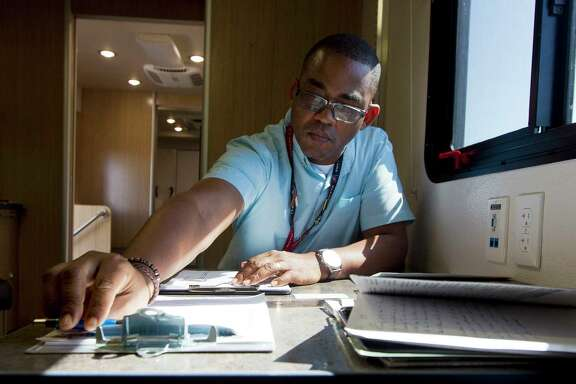 Veterans Outreach Program Specialist Marcus Smith goes through paperwork on Sept. 7 after visiting with a veteran at the Veterans Affairs' Mobile Vet Center in Porter. The mobile center is one of six such service centers in Houston.