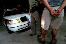 Texas Highway Patrol Officer Rafael Hernandez leads a suspected drunk driver to the patrol car in 1999. In Kendall County (as in Bexar), officers are allowed to get blood drawn if motorists refuse a breathalyzer and if a judge agrees. But judges there are balking.