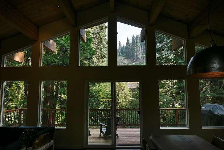 Views of Homewood Mountain Resort are seen from the living room of Will and Caryn Sloane's vacation home in Homewood, CA, on Saturday August 5, 2017.