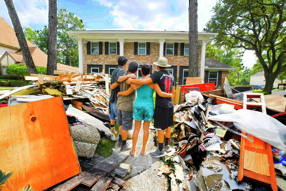 In the Norchester neighborhood, debris is piled up 4 to 5 feet high. Cleanup from the hundreds of flooded homes in the area could take months.  Photo: Tony Gaines, Photographer