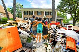 In the Norchester neighborhood, debris is piled up 4 to 5 feet high. Cleanup from the hundreds of flooded homes in the area could take months.