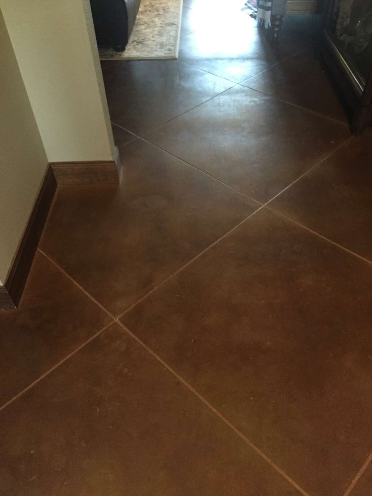 This concrete floor is stained to look like large squares of Saltillo tile. Melanie Bowles of A Creative Design did treatment on the concrete floor.