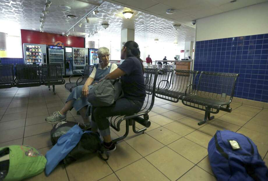 Sister Denise LaRock, left, of the Sisters of Charity of the Incarnate Word talks Aug. 29, 2017 with an undocumented immigrant waiting for a bus at the Greyhound station in downtown San Antonio. The woman and her children were dropped at the station after being released from a federal immigration detention facility. Photo: William Luther, Staff / San Antonio Express-News / © 2017 San Antonio Express-News