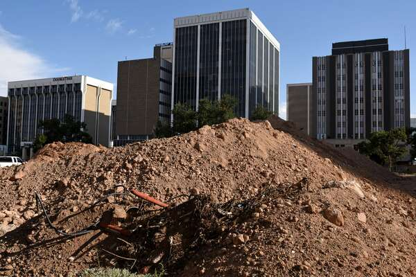 Dirt is piled up where the Midland County Courthouse once stood in Centennial Plaza, photographed Sept. 15, 2017. James Durbin/Reporter-Telegram