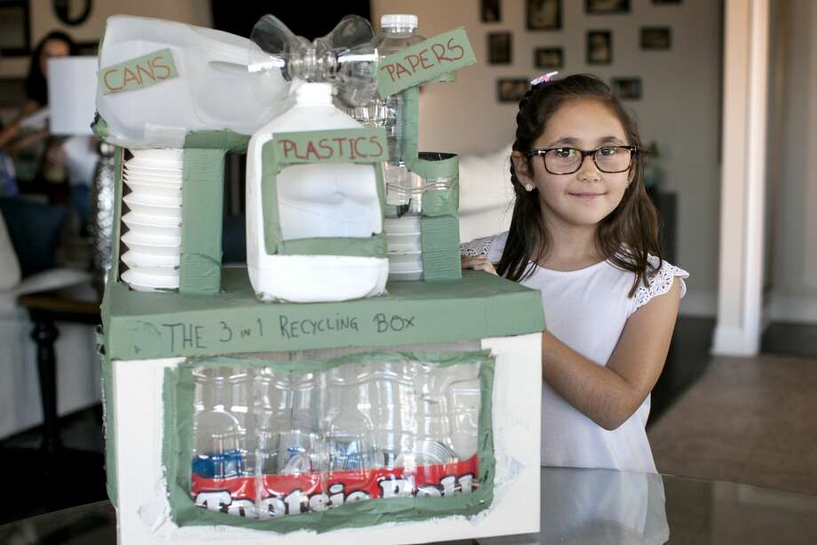 "Angelina Siletto, age 7, poses with her ""3-in-1 Recycling Box"" Sept. 13, 2017.  James Durbin/Reporter-Telegram Photo: James Durbin"