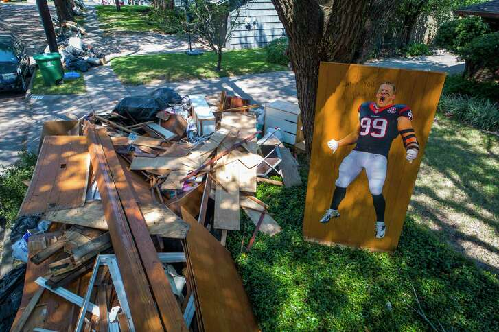 A JJ Watt decal has some choice words for Hurricane Harvey on a pile of debris in Meyerland. (Mark Mulligan / Houston Chronicle)