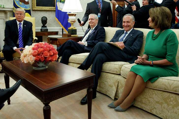 President Donald Trump meets with, from left, Senate Majority Leader Mitch McConnell, Senate Minority Leader Chuck Schumer,  House Minority Leader Nancy Pelosi and other congressional leaders in the Oval Office on Sept. 6.  (Evan Vucci / Associated Press)