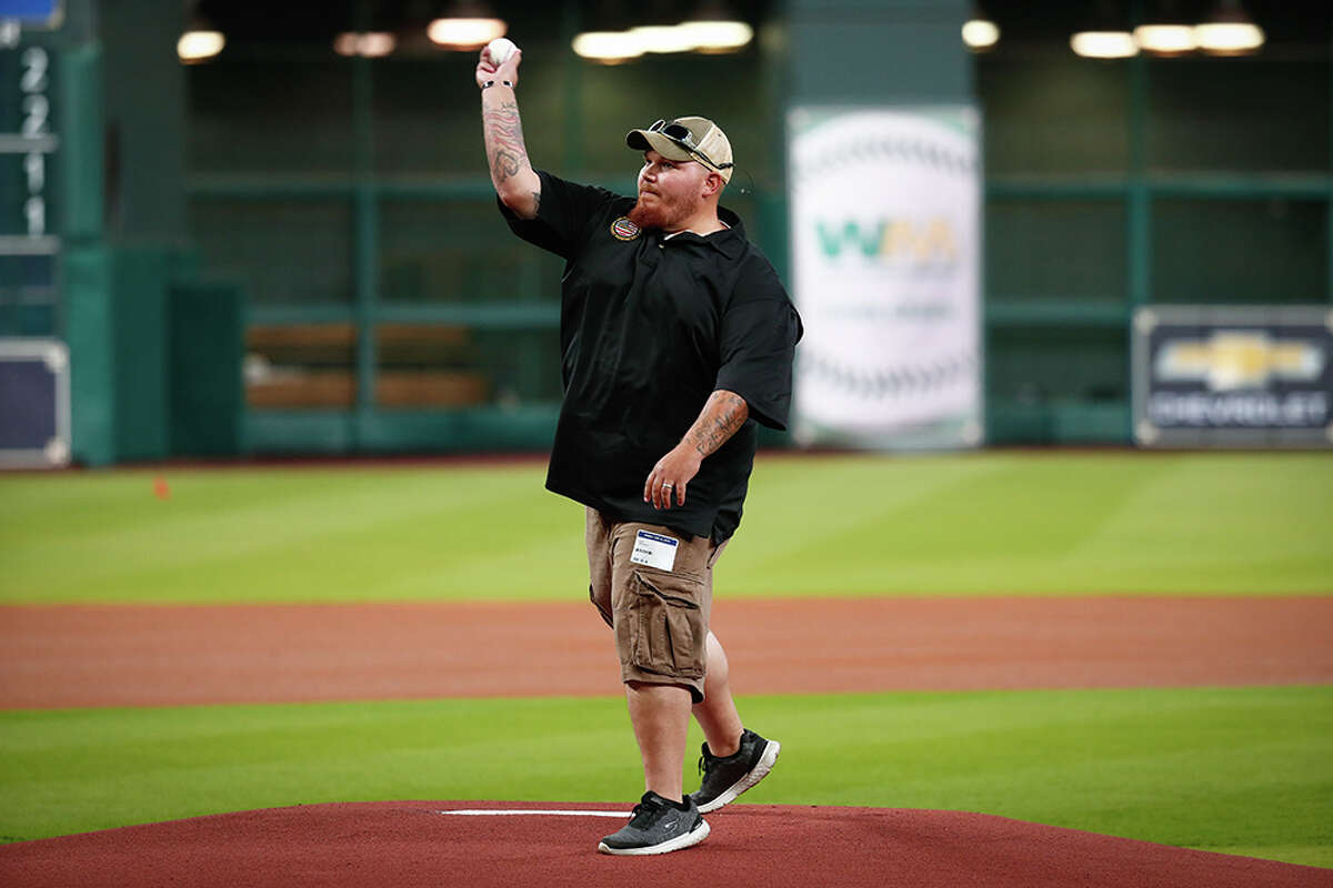 U.S. Army Specialist Matthew Connally threw out the first pitch before Saturday's Astros-Mariners game on Friday at Minute Maid Park, then the Astros surprised him with a 2018 Chevy Equinox.