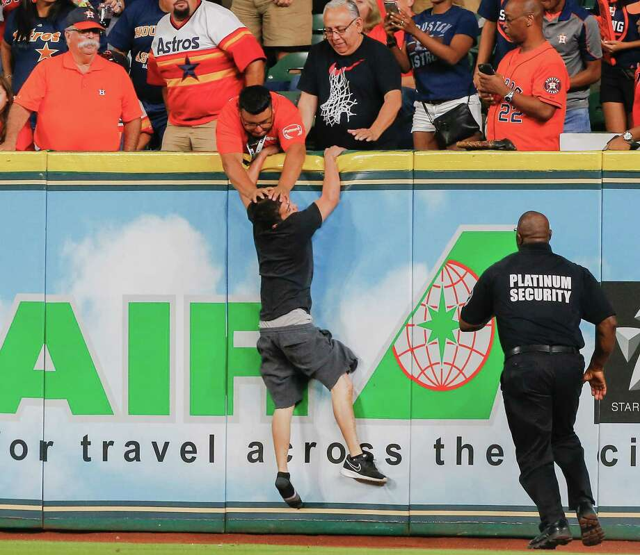 Fan on the fieldIn a 2017 game, a fan ran on the field and eluded security until he tried to climb the right-field wall and was stuffed by a security guard in the stands. Photo: Bob Levey, Getty Images / 2017 Getty Images