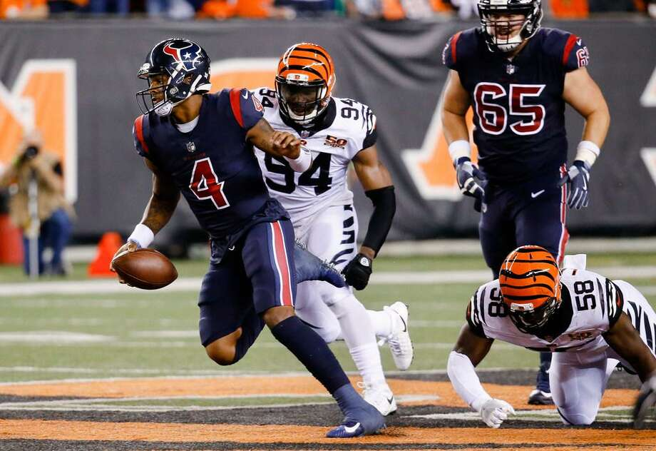Houston Texans quarterback Deshaun Watson (4) breaks away from Cincinnati Bengals defensive end Chris Smith (94) and linebacker Carl Lawson (58) to score a touchdown during the first half of the Texans' 13-9 victory Thursday. Photo: Frank Victores /AP Photo
