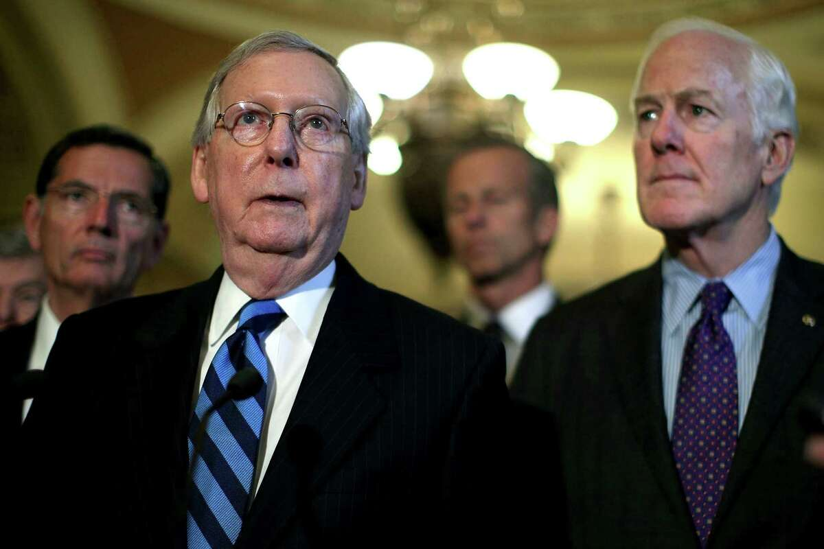 WASHINGTON, DC - JULY 11: U.S. Senate Majority Leader Sen. Mitch McConnell (R-KY) (2nd L) speaks as (L-R) Sen. John Barrasso (R-WY), Sen. John Thune (R-SD), and Senate Majority Whip Sen. John Cornyn (R-TX) listen during a news briefing after the weekly Senate Republican Policy Luncheon July 11, 2017 at the Capitol in Washington, DC. Sen. McConnell announced that Senate will delay its recess to the third week of August. (Photo by Alex Wong/Getty Images)