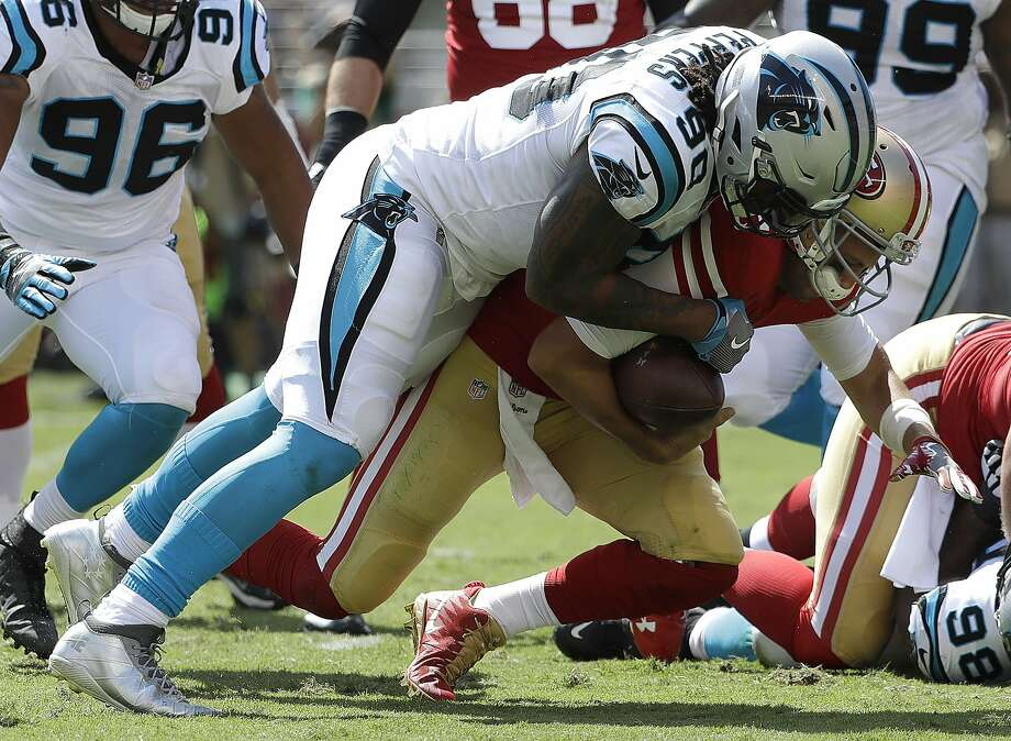 FILE - In this Sunday, Sept. 10, 2017 file photo, Carolina Panthers defensive end Julius Peppers (90) tackles San Francisco 49ers quarterback Brian Hoyer during the first half of an NFL football game in Santa Clara, Calif. Julius Peppers is on the verge of joining some elite company _ although the 37-year-old defensive end seemingly couldn't care less. Peppers picked up a half-sack in his return to the Panthers last Sunday and now has 144 for his career, inching closer to joining Bruce Smith, Reggie White, Kevin Greene and Chris Doleman as the only players in NFL history with 150 career sacks.(AP Photo/Marcio Jose Sanchez, File) Photo: Marcio Jose Sanchez, Associated Press