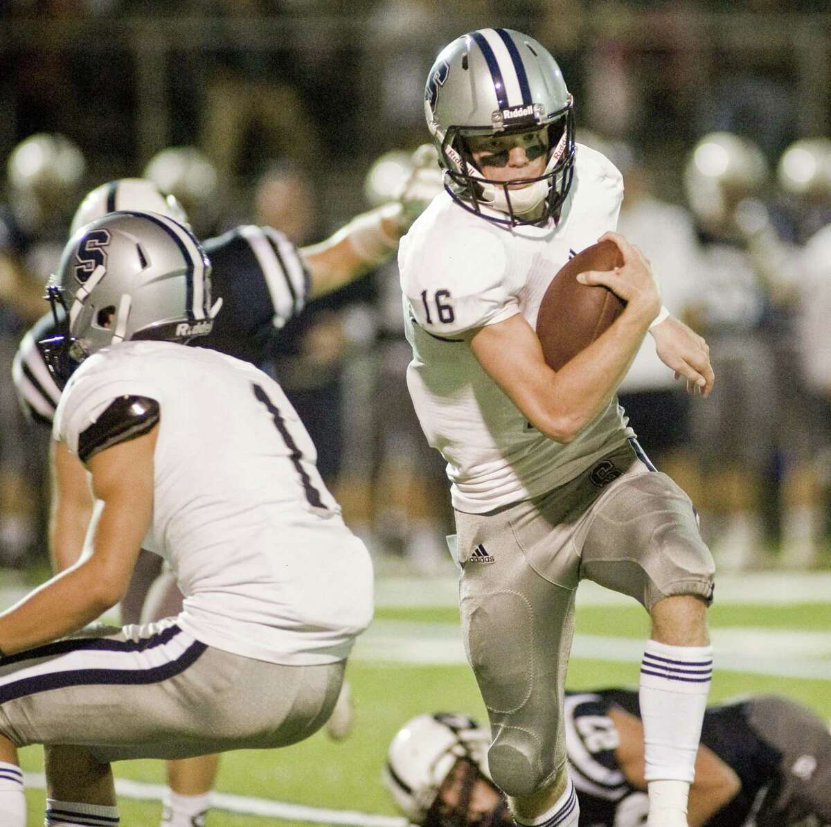 Staples High School quarterback Daniel Thompson carries the ball during a game against Wilton High School, played at Wilton. Friday, Sept. 15, 2017
