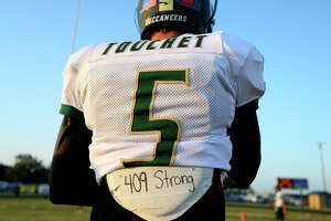 East Chambers' Tanner Touchet wears a Harvey-related message on his pads before the Rice Bowl rivalry football between Hamshire-Fannett and East Chambers. The two communities were both severely flooded by Tropical Storm Harvey.  Photo taken Friday 9/15/17 Ryan Pelham/The Enterprise