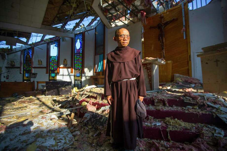 Father John Tran Nguyen leads St. Peter's Catholic Church, which was ripped apart when Harvey made landfall in Rockport. Photo: Mark Mulligan, Houston Chronicle / 2017 Mark Mulligan / Houston Chronicle