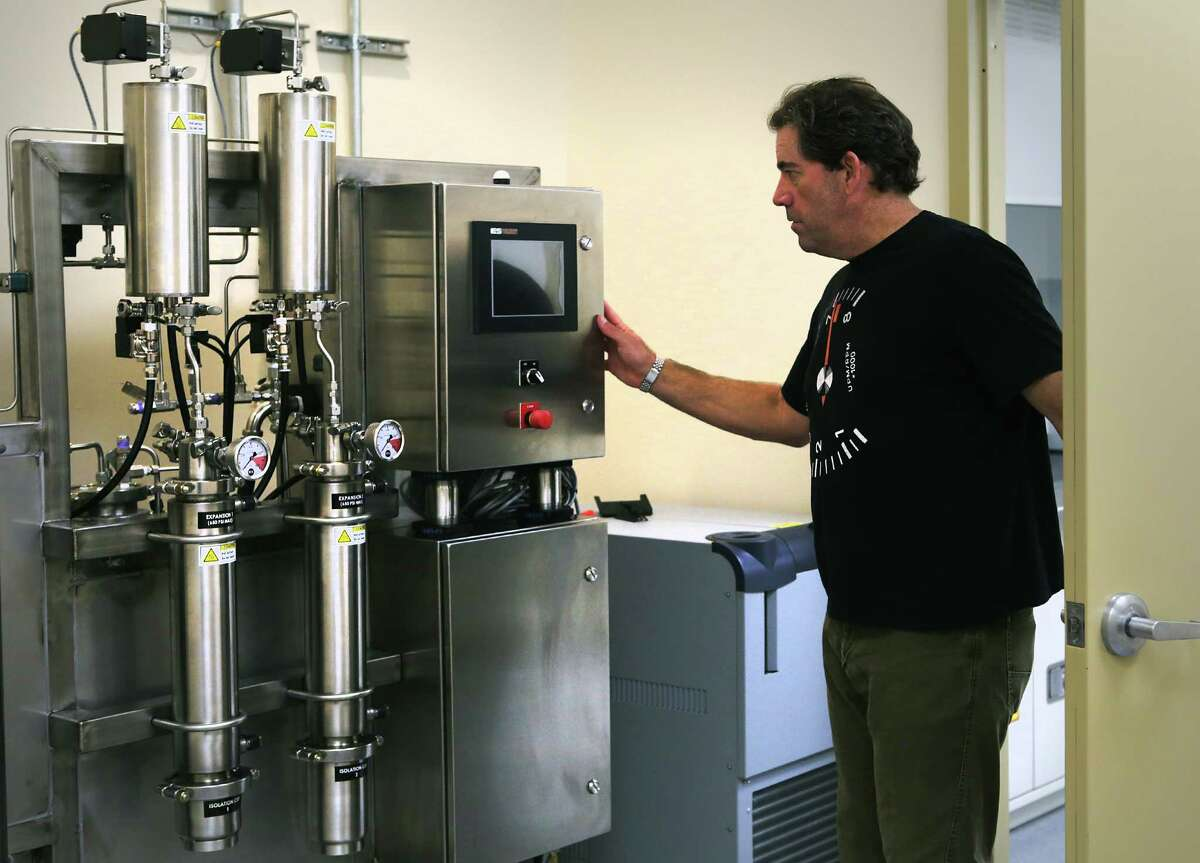 Morris Denton, CEO of Compassionate Cultivation, inspects his extraction machine that will turn marijuana plant matter into oil. Denton is one of only three entities expected to soon get a license to grow medical cannabis, in his soon to open location in South Austin.