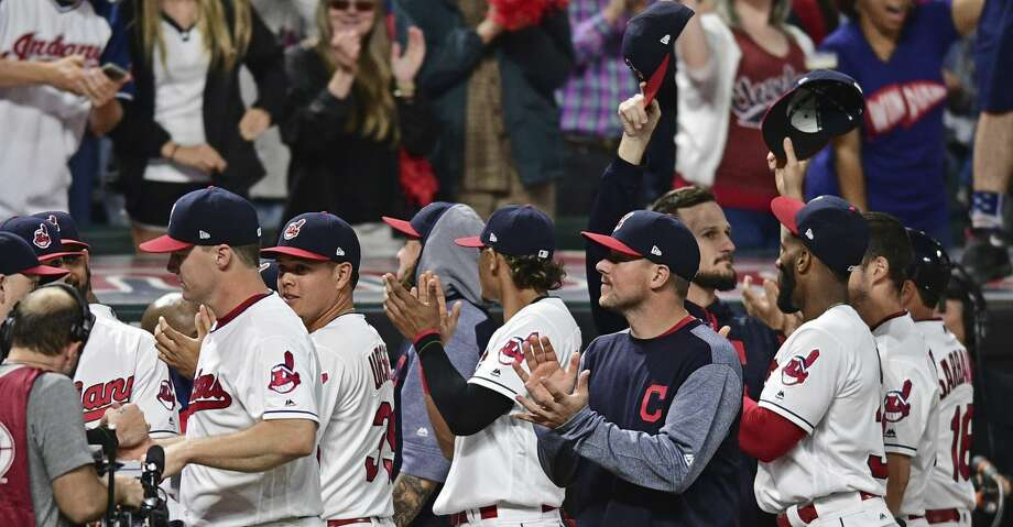 Cleveland Indians fans applaud the fans after the ninth inning of a baseball game against the Kansas City Royals, Friday, Sept. 15, 2017, in Cleveland. (AP Photo/David Dermer) Photo: David Dermer/Associated Press