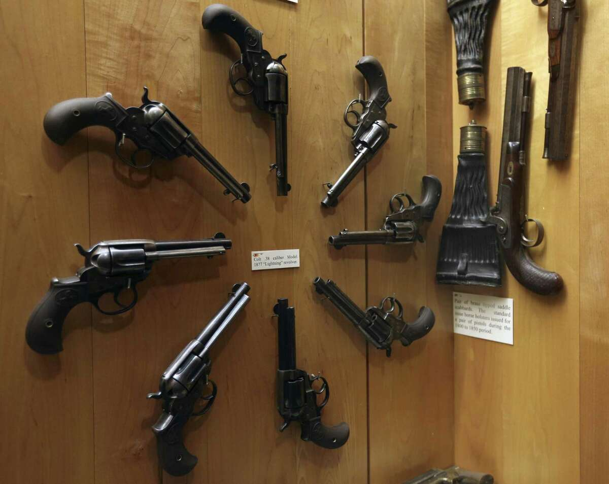 A small portion of McCombs' private collection of firearms is shown at his office building.