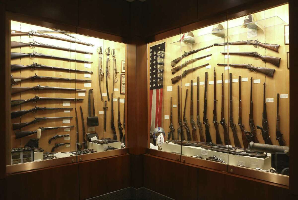 """A small portion of B.J. ?'Red?"""" McCombs' private collection of firearms is seen Aug. 24, 2017 in his near-north side office."""