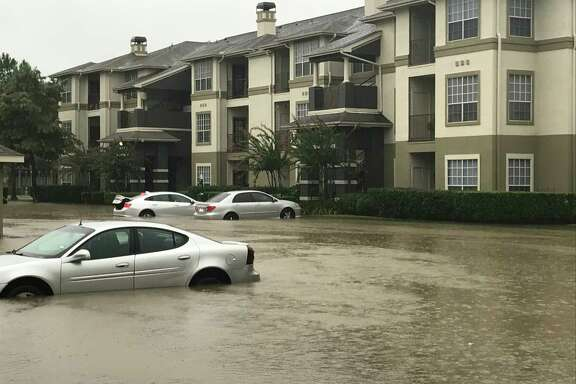 The Commons at Vintage Park apartments were waterlogged Sunday morning. The complex, near Cypress Creek, flooded in the Tax Day Floods of 2016. On Sunday, some residents tried to make a last-minute escape.