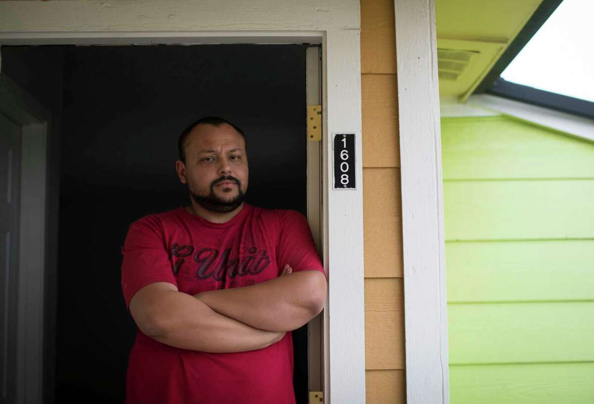 Steven Calhoun, 31, stands on the frame of the door of his apartment north of Houston, Wednesday, Sept. 13, 2017. Calhoun is facing an eviction notice. He works at George Bush Intercontinental Airport, but missed work days during the Hurricane Harvey and now is struggling financially. ( Marie D. De Jesus / Houston Chronicle )
