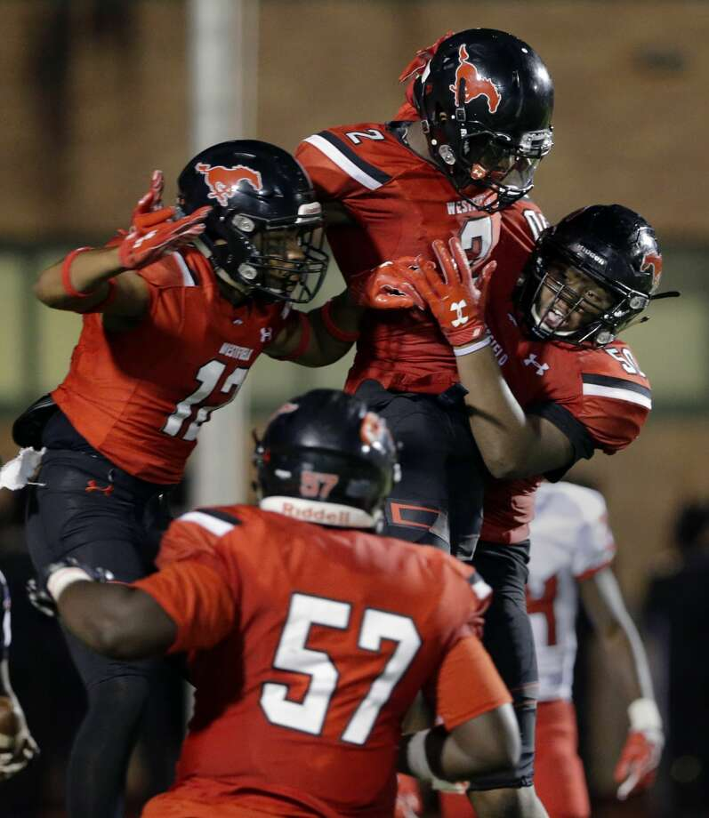 Westfield players (from left) Ra'Quon Washington (12), John Kennedy (57), Ali Walter (2) and Jawaun Singletary (50) celebrate Walter's touchdown against North Shore in the first half of their game at George Stadium in Spring, TX, Sept. 15, 2017. (Michael Wyke / For the  Chronicle) Photo: Michael Wyke/For The Chronicle