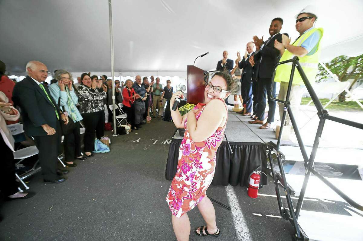 Chapel Haven community member Jamie Harberg, center, sings to a standing ovation during Friday's ground-breaking celebration.