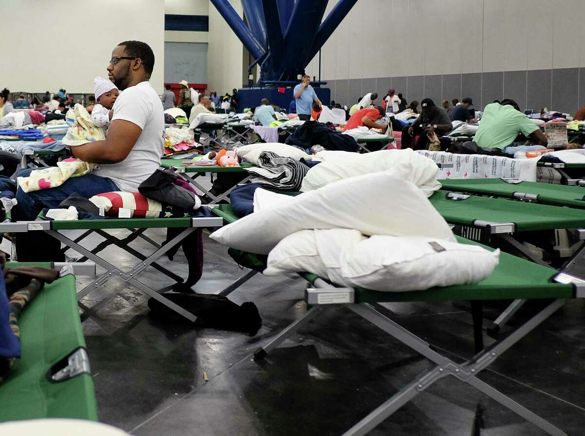 People displaced by Hurricane Harvey took shelter in the George R. Brown Convention Center, one of two mega shelters following the storm. The last Harvey evacuees were moved out of the convention center Sunday and relocated to other shelters.