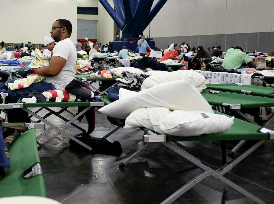 People displaced by Hurricane Harvey took shelter in the George R. Brown Convention Center, one of two mega shelters following the storm. The last Harvey evacuees were moved out of the convention center Sunday and relocated to other shelters. Photo: Elizabeth Conley, MBO / © 2017 Houston Chronicle