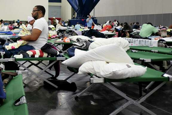 People displaced by Hurricane Harvey took shelter in the George R. Brown Convention Center. Some have been there for as long as three weeks but began moving to another facility on Friday.