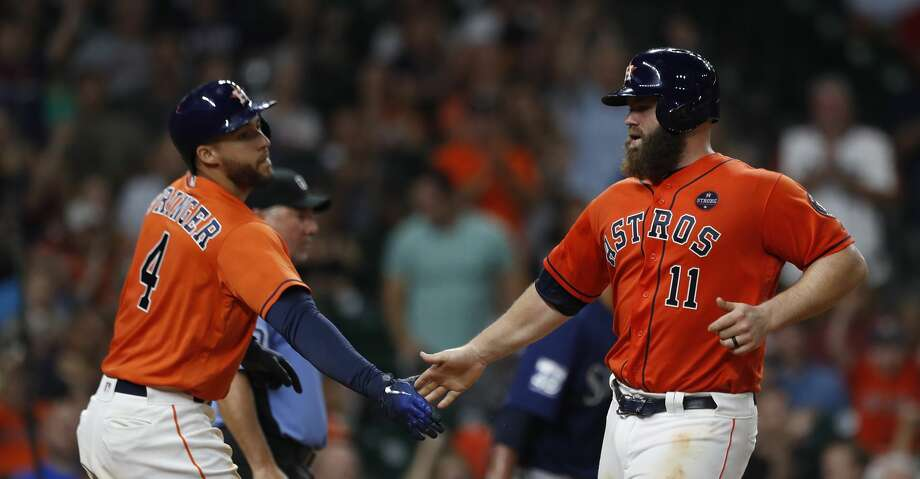 PHOTOS: Astros 5, Mariners 2Houston Astros Evan Gattis (11) celerates his run scored with George Springer (4)  on a single by Cameron Maybin during the sixth inning of an MLB baseball game at Minute Maid Park, Friday, Sept. 15, 2017, in Houston.  ( Karen Warren / Houston Chronicle )Browse through the photos to see action from the Astros' win over the Mariners on Friday night. Photo: Karen Warren/Houston Chronicle