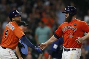 Houston Astros Evan Gattis (11) celerates his run scored with George Springer (4)  on a single by Cameron Maybin during the sixth inning of an MLB baseball game at Minute Maid Park, Friday, Sept. 15, 2017, in Houston.  ( Karen Warren / Houston Chronicle )