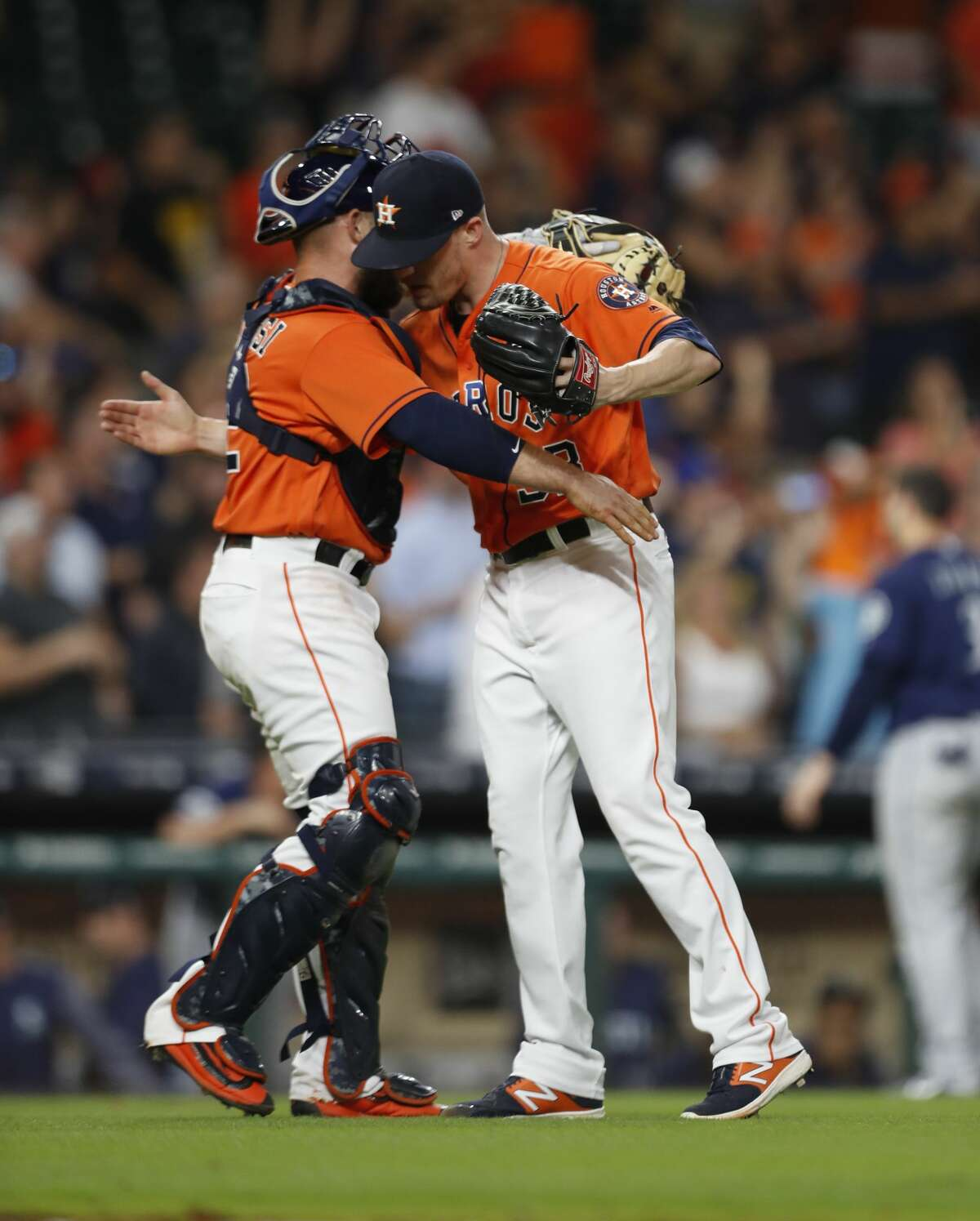Houston Astros relief pitcher Ken Giles (53) hugs catcher Max Stassi (12) after the Astros win 5-2 against the Seattle Mariners after an MLB baseball game at Minute Maid Park, Friday, Sept. 15, 2017, in Houston. ( Karen Warren / Houston Chronicle )