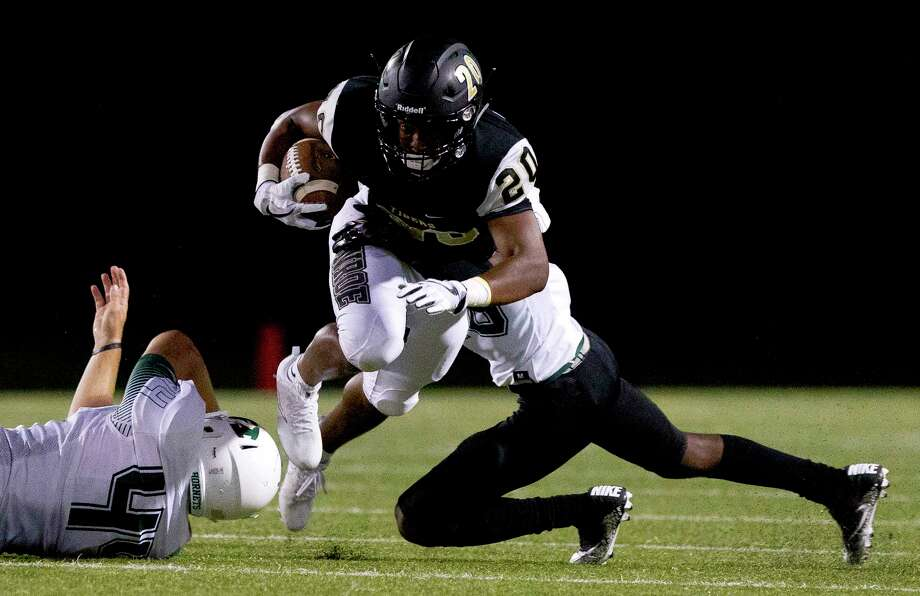 Conroe tailback Donaven Lloyd (20) is brought down after picking up a first down during the first quarter of a non-district high school football game at Buddy Moorhead Stadium, Friday, Sept. 15, 2017, in Conroe. Photo: Jason Fochtman, Staff Photographer / © 2017 Houston Chronicle