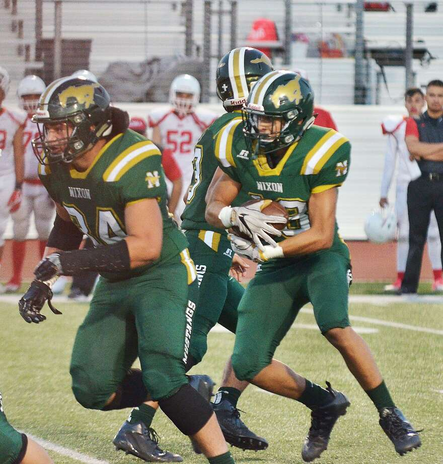 Emil Oliva runs behind tight end Fernando Hernandez Friday in Nixon's 27-7 win over Roma at Shirley Field. Oliva rushed for a career-high 137 yards and a touchdown and scored on a 58-yard pass. Hernandez also helped on special teams averaging 55 yards per punt. Photo: Cuate Santos /Laredo Morning Times