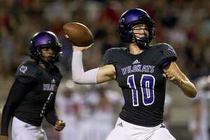 Willis quarterback Ty Backmann (10) drops back to pass during the fourth quarter of a non-district high school football game at Berton A. Yates Stadium, Friday, Sept. 15, 2017, in Willis.