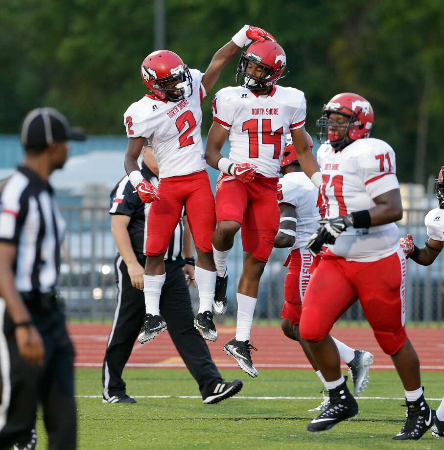 North Shore's Kerrion Hadnot and Trevion Bandy celebrate Bandy's touchdown against Westfield in the first half of their game at George Stadium in Spring, TX, Sept. 15, 2017. (Michael Wyke / For the  Chronicle) Photo: Michael Wyke/For The Chronicle
