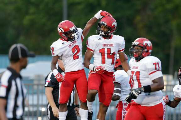 North Shore's Kerrion Hadnot and Trevion Bandy celebrate Bandy's touchdown against Westfield in the first half of their game at George Stadium in Spring, TX, Sept. 15, 2017. (Michael Wyke / For the  Chronicle)