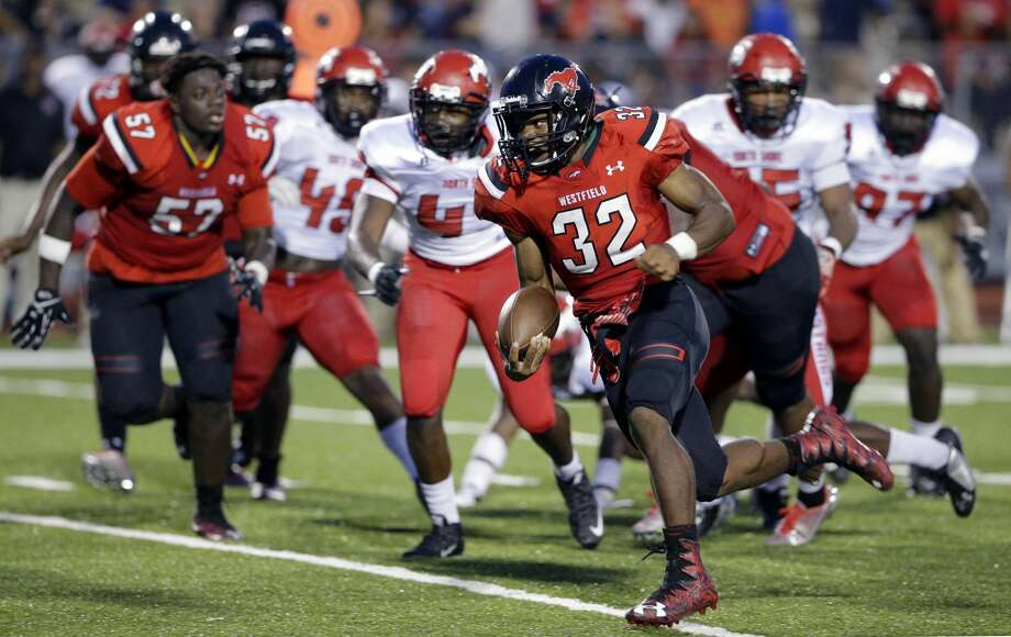 PHOTOS: Week 2 of HS football action  Westfield running back Edwin Allen runs around the pack for a gain against North Shore in the first half of their game at George Stadium in Spring, TX, Sept. 15, 2017. For the second time in three weeks, Houston-area fans will be treated to a matchup of the top two teams in the Houston media high school football Class 6A poll. Westfield and North Shore meet Thursday night. (Michael Wyke / For the Chronicle)  >>>See high school football action from Week 2 ...  Photo: Michael Wyke/For The Chronicle