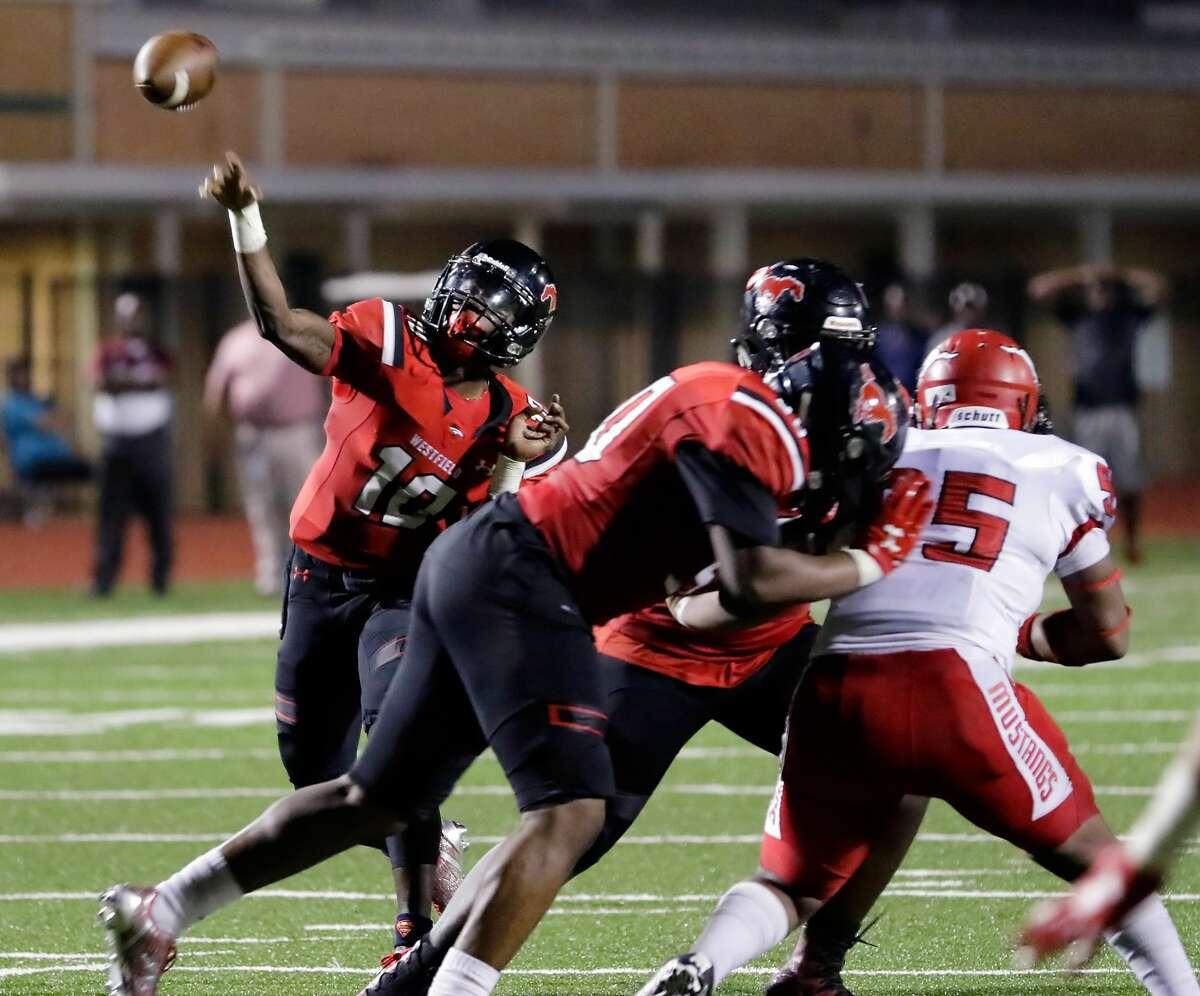 Westfield quarterback Terrance Gipson passes behind his protection against North Shore in the first half of their game at George Stadium in Spring, TX, Sept. 15, 2017. (Michael Wyke / For the Chronicle)